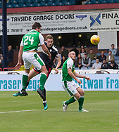 27th August 2017, Dens Park, Dundee, Dundee; Scottish Premier League football, Dundee versus Hibernian; Dundee's Kevin Holt gets in a header on goal