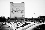 """Pomigliano D'Arco, Italia - L'enorme pannello che pubblicizza la nuova FIAT PAnda rigorosamente """"made in Pomigliano"""" montato all'ingersso dello stabilimento FIAT di Pomigliano D'Arco..Ph. Roberto Salomone Ag. Controluce.ITALY - The adverting banner seen at the entrance of the FIAT plant of Pomigliano D'Arco that advertises the new FIAT Panda car on December 13, 2011."""