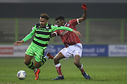 Forest Green Rovers Jordan Simpson(12) is tackled by Bristol City Tyreeq Bakinson(8) during the Gloucestershire Senior Cup match between Forest Green Rovers and U23 Bristol City at the New Lawn, Forest Green, United Kingdom on 9 April 2018. Picture by Shane Healey.