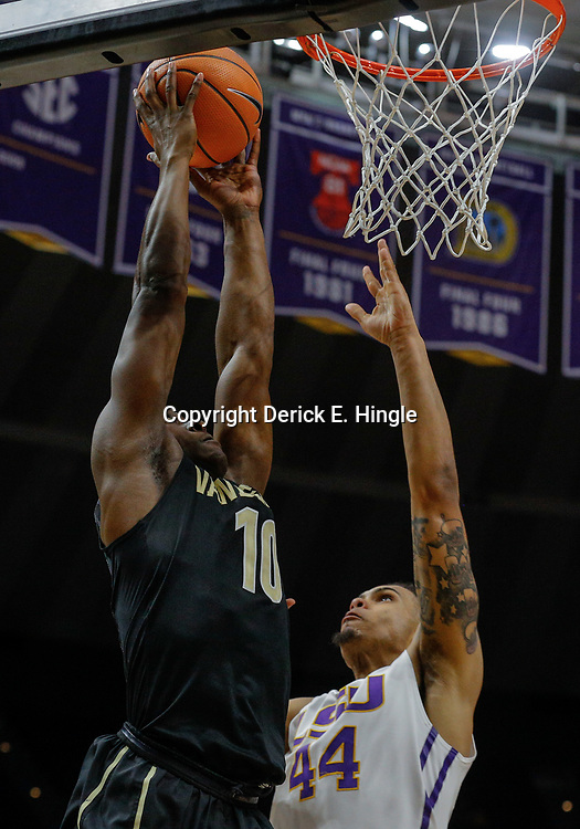 Feb 20, 2018; Baton Rouge, LA, USA; Vanderbilt Commodores guard Maxwell Evans (10) attempts a dunk against LSU Tigers forward Wayde Sims (44) during the first half at the Pete Maravich Assembly Center. Mandatory Credit: Derick E. Hingle-USA TODAY Sports