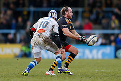 Wasps Fly-Half Andy Goode passes the ball as Castres Olympique Fly-Half Daniel Kirkpatrick challenges - Photo mandatory by-line: Rogan Thomson/JMP - 07966 386802 - 14/12/2014 - SPORT - RUGBY UNION - High Wycombe, England - Adams Park Stadium - Wasps v Castres Olympique - European Rugby Champions Cup Pool 2.