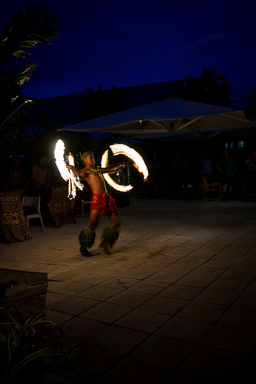 Fire knife dancing is a traditional Samoan ceremonial dance while twirling a knife and doing acrobatic stunts and setting a towel on fire.  Traditionally a machete is used.