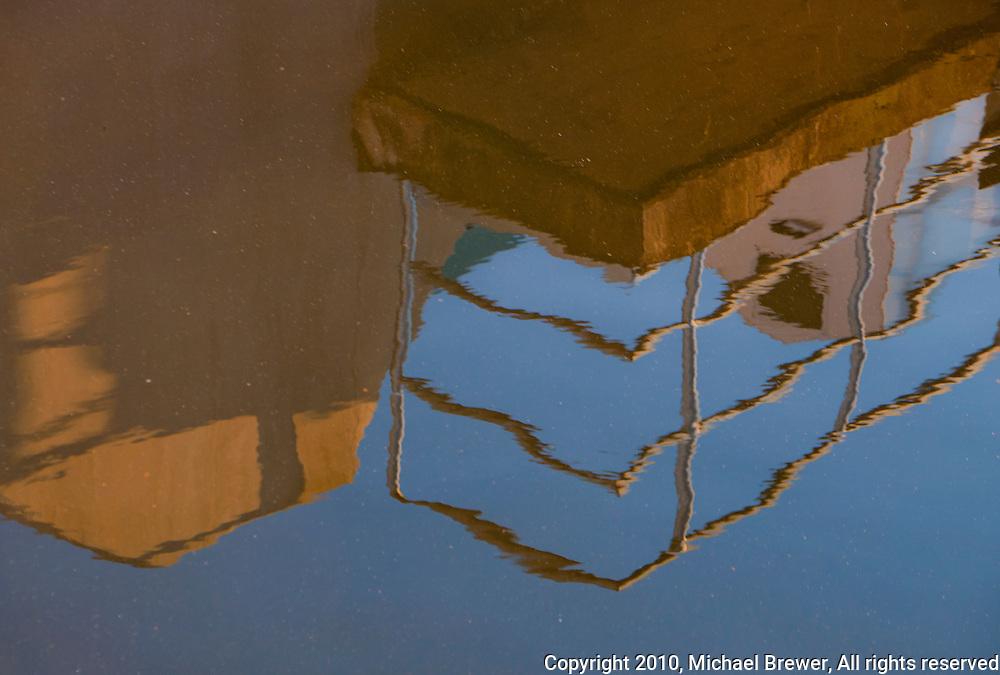 Still life reflection in a sewage treatment pond at Werdhölzli Sewage Treatment Plant, Zürich, Switzerland.