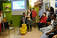 """Canada, Ontario. Windsor, 2016. Windsor Workers Education Centre hosts the opening reception of """"After Work"""", a migrant workers photo and video project by Collette Broeders and Douglas MacLellan. The MayWorks Windsor 2016 event attracts a crowd of about sixty people who listen to music, speakers and enjoy authentic Jamaican cuisine."""
