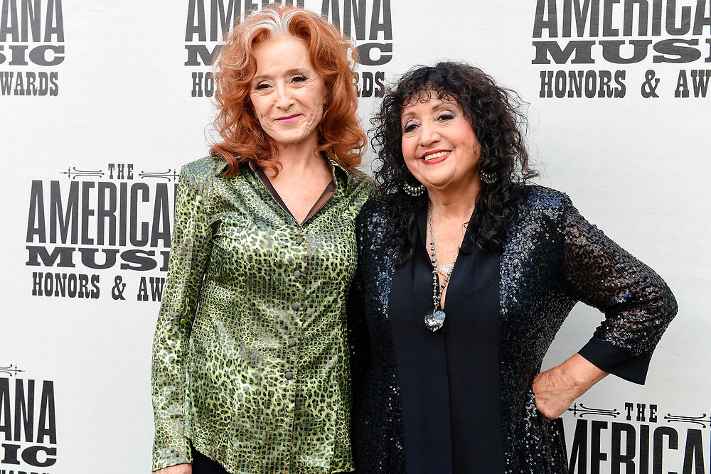 NASHVILLE, TENNESSEE - SEPTEMBER 11: (L-R) Bonnie Raitt  and Maria Muldaur  arrive at the 18th Annual Americana Honors & Awards at Ryman Auditorium on September 11, 2019 in Nashville, Tennessee. (Photo by Mickey Bernal/Getty Images)