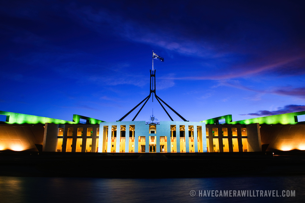 """Parliament House is the meeting place of the Parliament of Australia. It is located in Canberra, the capital of Australia. It was opened on 9 May 1988 by Queen Elizabeth II, Queen of Australia.[1] Its construction cost was over $1.1 billion. At the time of its construction it was the most expensive building in the Southern Hemisphere. Prior to 1988, the Parliament of Australia met in the Provisional Parliament House, which is now known as """"Old Parliament House""""."""