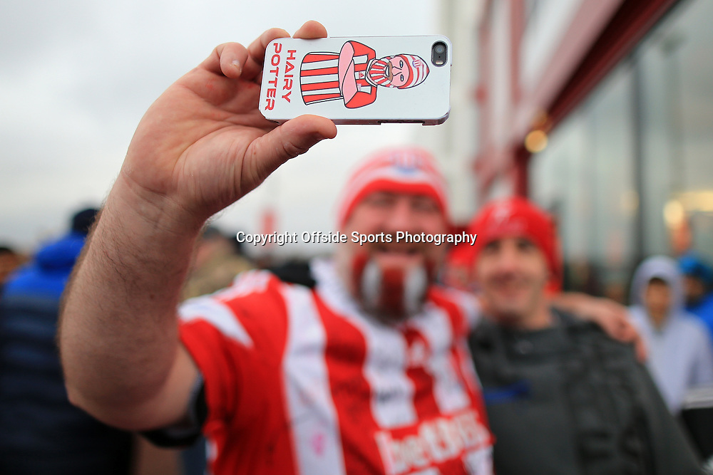 26th December 2015 - Barclays Premier League - Stoke City v Manchester United - Stoke fan 'Hairy Potter' takes a selfie on his mobile phone - Photo: Simon Stacpoole / Offside.