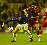Photo: Aidan Ellis.<br /> Everton v Dinamo Bucuresti. UEFA Cup. 29/09/2005.<br /> Everton's Kevin Kilbane is challenged by Dinamo's Florin Bratu