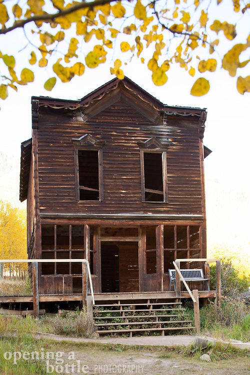 Historic and abandoned hotel, with golden aspen leaves, Ashcroft ghost town south of Aspen, Colorado.
