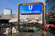 Entrance to the U-Bahn or underground train station in Alexanderplatz, with outdoor cafe and part of the Berolinahaus in the distance, Berlin, Germany. Picture by Manuel Cohen
