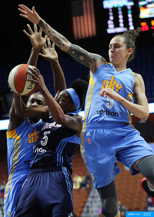 UNCASVILLE, CONNECTICUT- MAY 05:  Tiffany Hayes #15 of the Atlanta Dream drives to the basket as Jacki Gemelos, (right),  #5 of the Chicago Sky defends during the Atlanta Dream Vs Chicago Sky preseason WNBA game at Mohegan Sun Arena on May 05, 2016 in Uncasville. (Photo by Tim Clayton/Corbis via Getty Images)