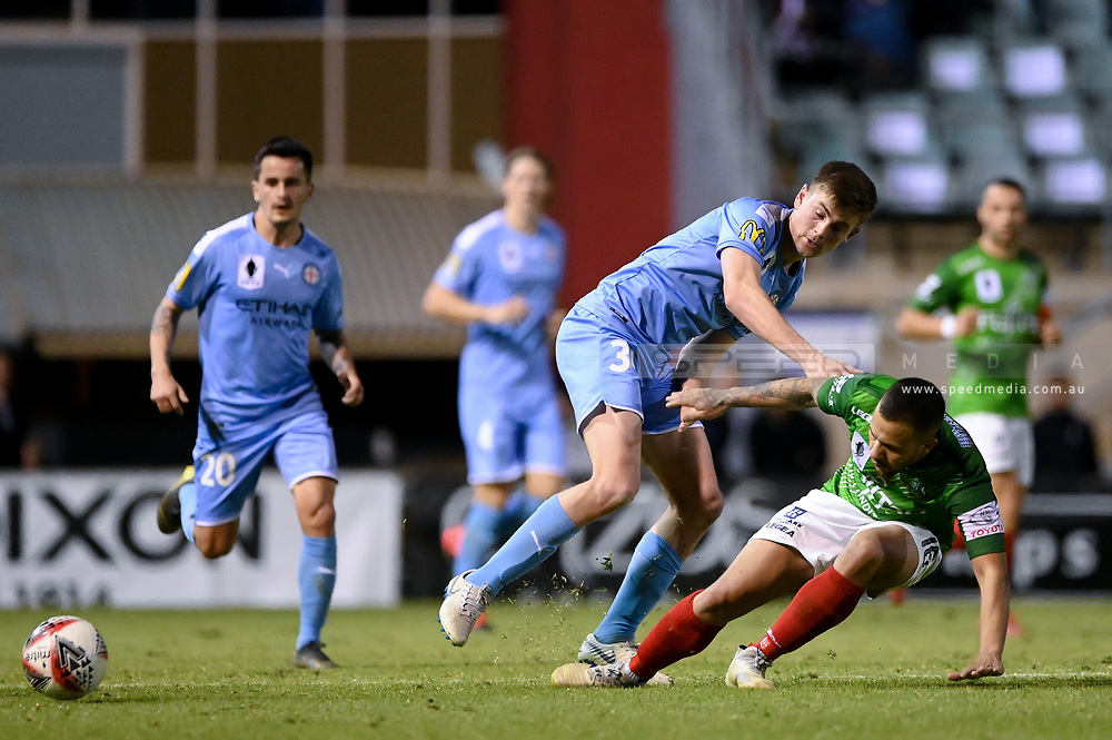 SYDNEY, AUSTRALIA - AUGUST 21: Melbourne City player Connor Metcalfe (34) and Marconi Stallions player Liam Youlley (16) fight for the ball during the FFA Cup round of 16 soccer match between Marconi Stallions FC and Melbourne City FC on August 21, 2019 at Marconi Stadium in Sydney, Australia. (Photo by Speed Media/Icon Sportswire)