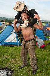 © Licensed to London News Pictures. 25/06/2015. Pilton, UK. Festival campsite atmosphere at Glastonbury Festival 2015 on Thursday Day 2 of the festival - Disco Dave and his owner Ioan Pearce from Blaernarvon, Wales.  It is Disco Dave's 5th festival.  This years headline acts include Kanye West, The Who and Florence and the Machine, the latter having been upgraded in the bill to replace original headline act Foo Fighters.   Photo credit: Richard Isaac/LNP