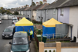 © Licensed to London News Pictures. 18/09/2017. London, UK. Yellow and blue tents stand at the entrance to a house in Sunbury, west London, where detectives investigating the Parsons Green tube bombing are continuing to search for clues. Investigations are continuing into the failed bombing of an underground train at Parsons Green station on September 15, 2017. Detectives have searched three properties and have two people in custody. Photo credit: Peter Macdiarmid/LNP