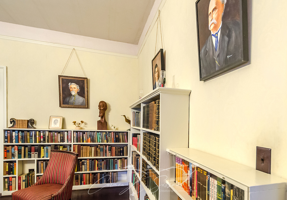 William Faulkner's library is pictured at his home at Rowan Oak, May 30, 2015, in Oxford, Mississippi. The room was originally his writing room until his study was built in 1952. Faulkner built the bookcases himself. The paintings on the wall are, from left, William clark Falkner, his great-grandfather; Murry Cuthbert Falkner, his father; and John Welsey Thompson Falkner, his grandfather. They were painted by his mother, Maud Butler Falkner. (Photo by Carmen K. Sisson/Cloudybright)