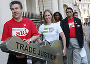 Trade Justice movement delegates with a key to Unlock poverty to give to   the German Ambassador outside the German embassy.