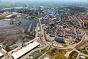 Nederland, Groningen, Delfzijl, 01-05-2013; overzicht centrum van Delfzijl, gezien naar Eemskanaal. Links haven Delfzijl met droogdokken en jachthaven Neptunus.<br /> Town centre and Delfzijl harbor with docks and marina Neptune. In the background the Ems.<br /> luchtfoto (toeslag op standard tarieven);<br /> aerial photo (additional fee required);<br /> copyright foto/photo Siebe Swart
