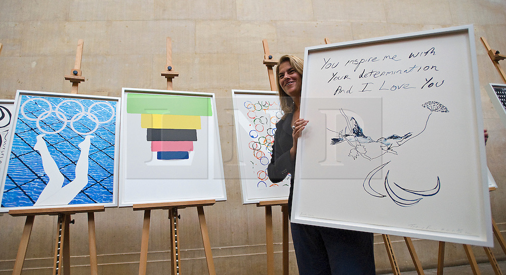 © London News Pictures. 04/11/2011. London, UK. Artist Tracey Emin  Whiterhead holding her artwork titled 'Birds 2012'  at the unveiling of the official Olympic and Paralympic posters for the London 2012 games by some of the UK's leading artists at The Tate Britain Gallery in London, UK today (04/11/2011). Photo Credit : Ben Cawthra/LNP