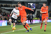 Millwall defender Jake Cooper and Derby County forward David Nugent during the EFL Sky Bet Championship match between Derby County and Millwall at the Pride Park, Derby, England on 20 February 2019.