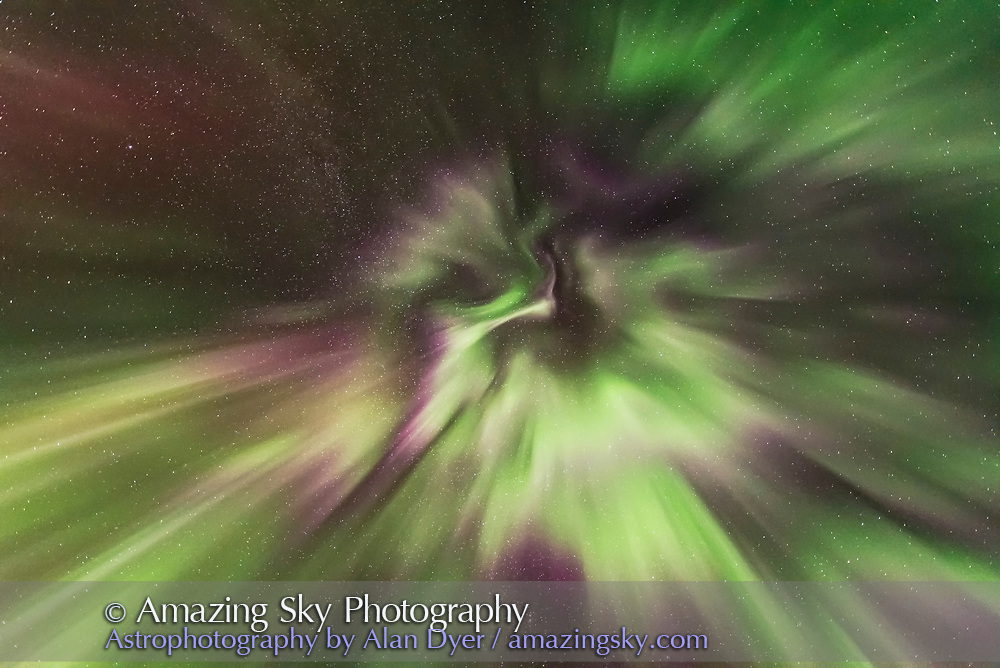 The aurora display of September 27, 2017 from home in southern Alberta, in a view looking straight up to the zenith, toward converging curtains and flaming patches. The pinks are from lower altitude nitrogen molecules. <br /> <br /> This is a single exposure as part of a 300-frame time-lapse, of 2 seconds at f/1.8 with the Sigma 14mm Art lens, and Nikon D750 at ISO 6400.
