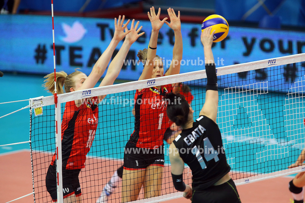 Japan Yukiko Ebata spikes against Belgium Lise Van Hecke and Belgium Angie Bland