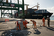 Work is performed to the unloading area of the shipping container terminal of the new Special Development Zone of Mariel on July 10, 2015 in Mariel, Cuba. (David Albers/Staff)