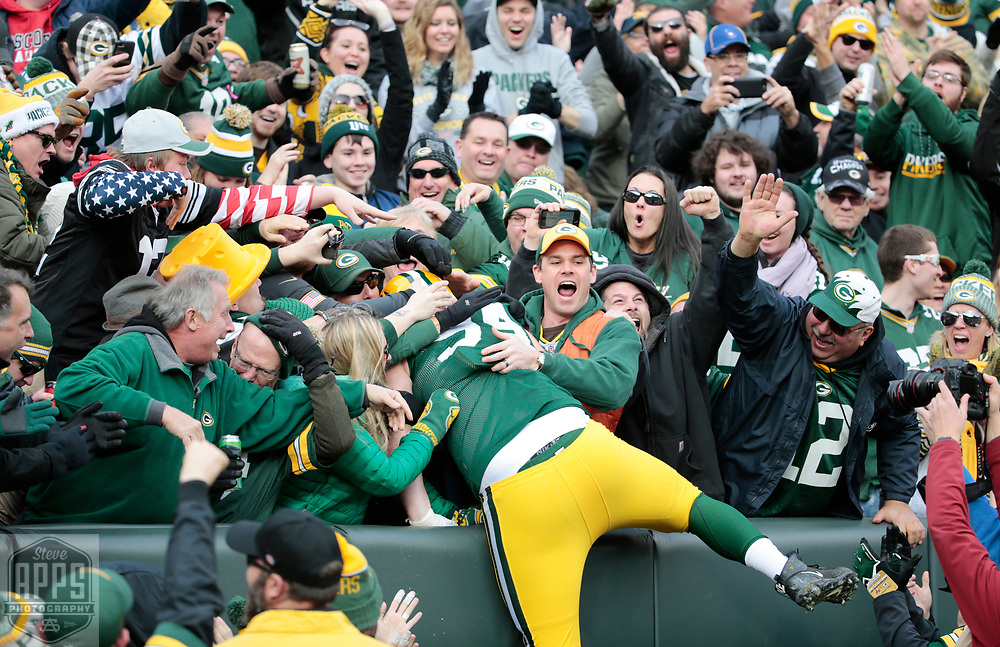 Green Bay Packers defensive end Dean Lowry (94) celebrates his 62-yard fumble recovery for a touchdown in the 2nd quarter. <br /> The Green Bay Packers hosted the Tampa Bay Buccaneers at Lambeau Field in Green Bay,  Sunday, Dec. 3, 2017.  STEVE APPS FOR THE STATE JOURNAL.