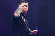 Gary Anderson beats Brendan Dolan in the second round and celebrates during the PDC William Hill World Darts Championship at Alexandra Palace, London, United Kingdom on 16 December 2019.