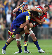 Israel Dagg is up-ended by Nasi Manu..Investec Super Rugby - Highlanders v Crusaders, 19 March 2011, Carisbrook Stadium, Dunedin, New Zealand..Photo: Rob Jefferies / www.photosport.co.nz