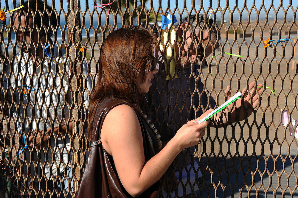 Tijuana Mexico ..Poets from the activist group 'border meetup' used to read poems through the border fence. Today they use sign language because a second fence makes direct contact inpossible. The group is organized by poet Daniel Watman...While working on this long term project 'La Frontera' I want to examine the cultural and humanitarian activities on both sides of a border that keeps the United States and Mexico apart with a wall of steel already 600 miles long. The turf wars of drug cartels, arms trafficking and rampant kidnappings turned cities like Tijuana into some of the most dangerous places on earth. Despite the violence many brave artists, photographers, architects, poets, humanitarians, teachers etc live and work in the shadow of the wall on both sides and have a positive influence on this region; they are the focus of my long term project along the border. (Over time I plan to cover the entire length from the Atlantic to the Pacific, these images were taken in and around Tijuana).© Stefan Falke..© Stefan Falke