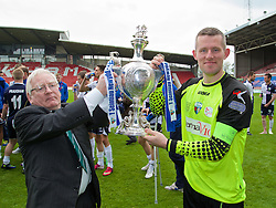 WREXHAM, WALES - Saturday, May 3, 2014: The New Saints' goalkeeper and captain Paul Harrison celebrates with the trophy after beating Aberystwyth Town 3-2 to win the Welsh Cup Final at the Racecourse Ground. (Pic by David Rawcliffe/Propaganda)