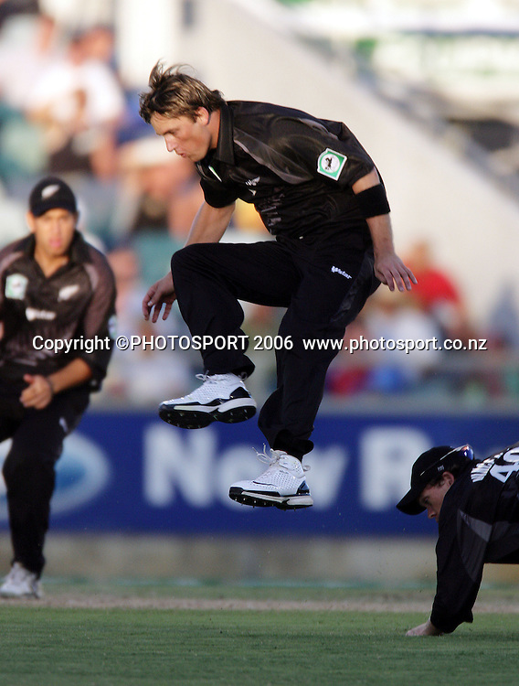 New Zealand fast bowler Shane Bond leaps to avoid a collission with Lou Vincent in the field during the one day international cricket match between New Zealand and England at the WACA ground in Perth on Tuesday 30 January, 2007. New Zealand won by 58 runs. Photo: Andrew Cornaga/PHOTOSPORT<br />