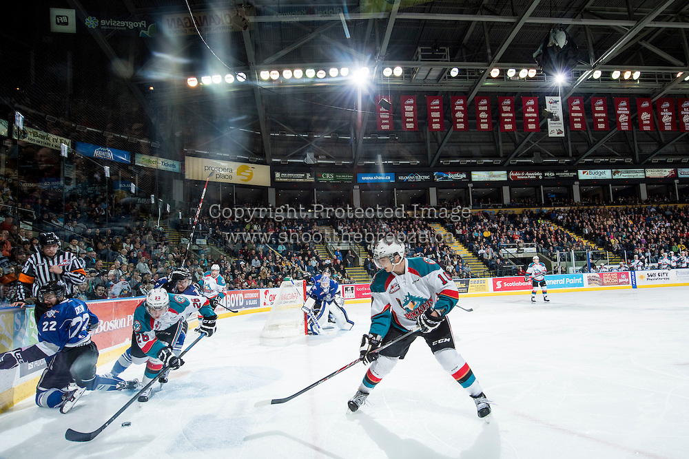 KELOWNA, CANADA - MARCH 11: Nick Merkley #10 looks for the pass as Cole Linaker #26 of the Kelowna Rockets steals the puck from Taylor Crunk #22 of Victoria Royals of Kelowna Rockets on March 11, 2015 at Prospera Place in Kelowna, British Columbia, Canada.  (Photo by Marissa Baecker/Shoot the Breeze)  *** Local Caption *** Nick Merkley;Cole Linaker; Taylor Crunk;