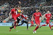 Liverpool's Defender Alberto Moreno and Newcastle United's Midfielder Siem de Jongbattle for the ball  during the Barclays Premier League match between Newcastle United and Liverpool at St. James's Park, Newcastle, England on 6 December 2015. Photo by George Ledger.