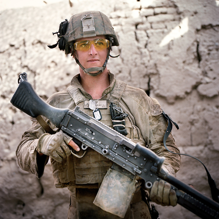 Location:<br /> Patrol Base Fires, Sangin District, Helmand Province, Afghanistan<br /> <br /> Unit: <br /> 3rd Squad, 1st Platoon, Bravo Company, 1st Battalion, 5th Marines<br /> <br /> Name and Rank: Lance Corporal David James Richvalsky<br /> <br /> Age: 19<br /> <br /> Hometown: Waialua, Hawaii<br /> <br /> Why did you join the Marine Corps?<br /> <br /> &quot;I joined the Marine Corps because I wanted to get off the island of Hawaii. I was slightly patriotic, and . . . I don&rsquo;t know, that&rsquo;s really the only reason I had. . . . I joined the Marine Corps out of all the other branches because I wanted to fight.&quot;<br /> <br /> Tell me about all of the weight you carry as a machine gunner:<br /> <br /> &quot;I carry obviously an M 240-B Machingun, and it weighs 27.1 pounds. And I carry 500 rounds for it on my body, but in the squad we carry eight hundred. A hundred rounds weighs 7.7 pounds, so if you do the math it adds up. I also carry a night optic for it, a 17 Charlie. It&rsquo;s not very heavy but it adds up too. I also carry PVS-14s which is like night vision, and I also carry about eight waters.&quot;<br /> <br /> &quot;I carry 35 pounds in rounds, 27 pounds in gun . . . I probably carry about maybe 60-65 pounds worth of gun gear only, not counting my flak and my water and all that shit.&quot;<br /> <br /> What does it do to your body?<br /> <br /> &quot;It feels like I&rsquo;m an old man, like I&rsquo;m just gonna fall apart.&quot;<br /> <br /> &quot;It&rsquo;s just what the Marine Corps does, they just break you down in boot camp. Like, they&rsquo;ll never really build you up.&quot;<br /> <br /> Describe your living conditions:<br /> <br /> &quot;I live in a fucking mud hut. It&rsquo;s just about three feet thick walls of mud, the hajjis live in. And right now it&rsquo;s actually pretty dirty just because I&rsquo;ve been disgusting and not cleaned it, and I got fleas because of the fucking chickens that run around.&quot;<br /> <br /> What is your role as a machine gunner during a firefight?<br /> <br /> &quot;Well, I always like doing my job when I&rsquo;m shootin&rsquo;, 'cause that makes carrying the 240 around not just seem like a giant piece of metal that&rsquo;s pulling me into the earth slowly. But, like, getting shot at, it&rsquo;s not fun. It&rsquo;s fun when