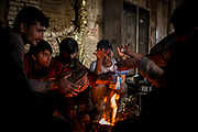 Migrants from Pakistan warming up next to a bone fire in an abandoned brick factory in Subotica few kilometers from the Hungarian border. Migrants are still trying to cross even after the Hungarian police reinforced their personel on the border. migrants pays abourt 1500 euros to smiugglers to try to cross, but the chanches are very fews. March 17th, 2017, Belgrade, Serbia. Federico Scoppa/CAPTA