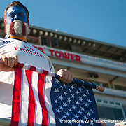 A United States fans rolls up his flag after the United States lose to the New Zealand All Blacks during the 2015 HSBC Sevens World Series  at Sam Boyd Stadium in Las Vegas, Nevada. Sunday February 15, 2015.<br /> <br /> COPYRIGHT &copy; JACK MEGAW, 2015. <br /> <br /> www.jackmegaw.com