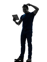 one  man holding digital tablet brushing hair in silhouette on white background