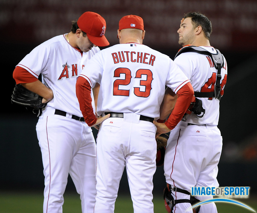 May 28, 2008; Anaheim, CA, USA; Los Angeles Angels pitching coach Mike Butcher (23) talks with pitcher Joe Saunders (51) and catcher Mike Napoli (44) during game against the Detroit Tigers at Angel Stadium. Mandatory Credit: Kirby Lee/Image of Sport-US PRESSWIRE