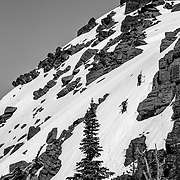 Andy Mahre and David Steele hiking up a ridgeline for their next set of turns.
