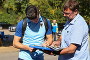 AFC Wimbledon midfielder Callum Reilly (33) signing autographs during the EFL Sky Bet League 1 match between AFC Wimbledon and Bristol Rovers at the Cherry Red Records Stadium, Kingston, England on 21 September 2019.