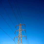 Electricity Pylons against a clear blue Sky