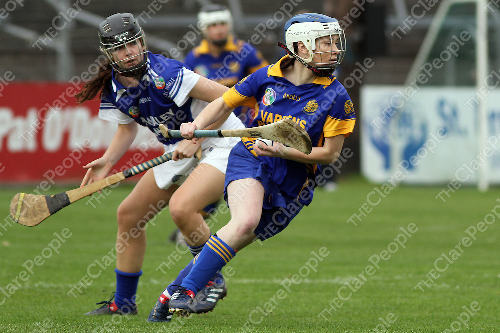 Aine O'Brien (Newmarket-on-Fergus) gets by the challenge of Kilmaley's Lorna Higgins. - Photograph by Flann Howard