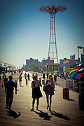 People enjoying the summer on Coney Island's boardwalk, Brooklyn, New York, 2010.