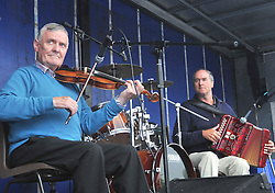 Liam Grealis and Tommy Lyons entertaining the crowd with a set of traditional tunes at Murrisk Pattern Day on sunday last.<br /> Pic Conor McKeown