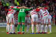 Doncaster Rovers huddle before kick off during the The FA Cup 5th round match between Doncaster Rovers and Crystal Palace at the Keepmoat Stadium, Doncaster, England on 17 February 2019.