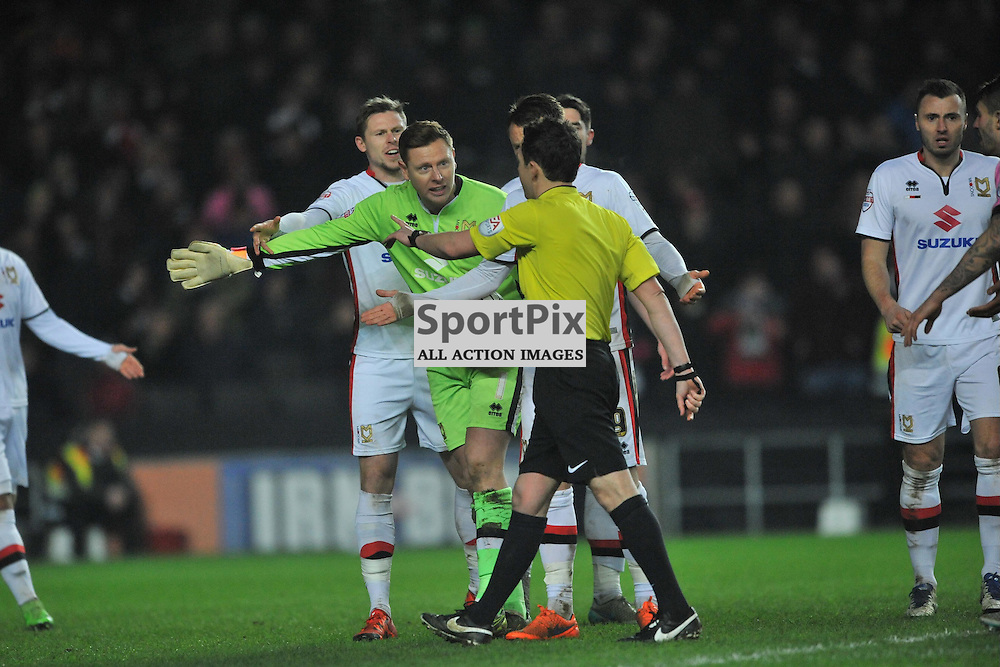 MK DONS KEEPER DAVID MARTIN FALLS BACK OVER HIS LINE WHICH NORTHAMPTON CELEBRATE AS THE LINESMAN GIVES THE GOAL, BUT REFEREE TONY HARRINGTON DISS ALLOWS AND GIVES A FOUL ON THE KEEPER  ,   MK Dons v Northampton Town, FA Cup Emirates FA Cup Third round Repay, Stadium MK, Tuesday 19th January 2016