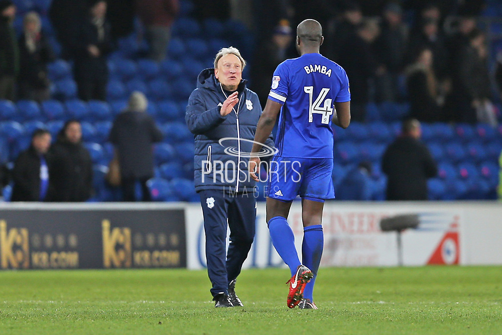 Cardiff City  Manager  Neil Warnock congratulates   Cardiff City  Souleymane Bamba (14) the goal scorer during the EFL Sky Bet Championship match between Cardiff City and Hull City at the Cardiff City Stadium, Cardiff, Wales on 16 December 2017. Photo by Gary Learmonth.
