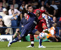 Photo: Olly Greenwood.<br />Southend United v Cardiff City. Coca Cola Championship. 24/09/2006. Cardiff's Joe Ledley tackles Southend's Jamal Campbell-Ryce