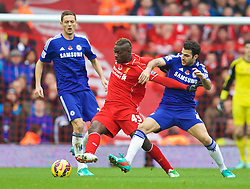 LIVERPOOL, ENGLAND - Saturday, November 8, 2014: Liverpool's Mario Balotelli in action against Chelsea's Cesc Fabregas during the Premier League match at Anfield. (Pic by David Rawcliffe/Propaganda)